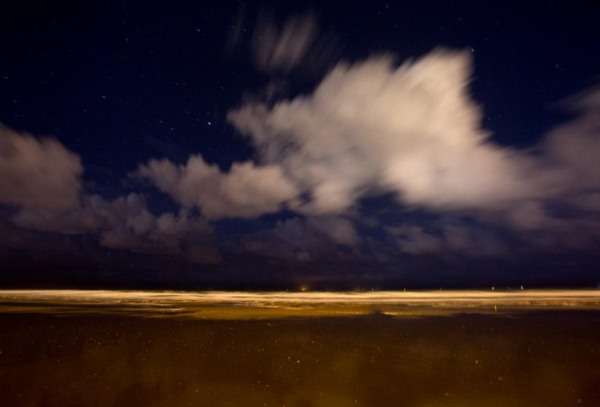 Photo of the North Sea beach at night, Ostend, Belgium